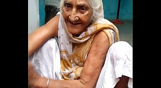 My sweet grandmother is laughing while she was bathing in the morning at village 4K